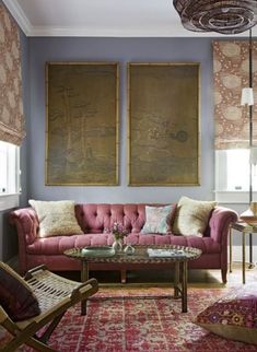 Color Tip: Don't feel like each element in a chosen color has match perfectly. Use the entire family of tones, tints and shades throughout the room. The living room above uses various shades of rosy red, purple-y brown, and darker plum, but still maintains the overall scheme. In fact, the slight variations keep the room from looking too pat and overly designed.