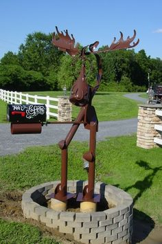 Moose sculpture Holding Mail Box