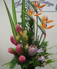 A tropical assortment sure to please - Birds of Paradise, Ginger, Protea, Leucodendron, Dendrobium orchids and a lovely assortment of greenery to accent
