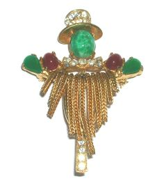 "Signed Weiss fringed scarecrow pin with simulated jade, ruby and clear rhinestones. Measures 2 1/2"" x 1 3/4"". Gold tone metal with safety catch pin stem. $92.00. Free shipping in the US. Questions? PM me via FB. PayPal Only."