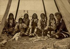 Jicarilla Apache group inside a lodge including Pouche Te Foya (4th from the right), and James Garfield Velarde (3rd from the right) - 1898