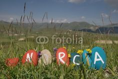 I love Norcia, colourful stones composition on the grass