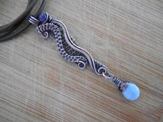 Flowing Owyhee Blue Opal Drop and Dark Amethyst by OurFrontYard, $29.77 ( Love this simple stone with a bit of jazz)