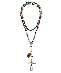 """This festive necklace by Love Tokens features a vintaged cross, copper Saint Christopher charm, and a Our Lady Guadalupe charm that is connected to a 40"""" strand of assorted precious stone beads. Rosary measures an overall 27"""" and is long enough that a necklace closure should not be needed. Pairs wonderfully with a floppy hat and boots. Proudly made in the USA."""