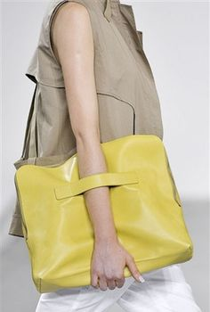 3.1 Phillip Lim   A slouchy, over-sized clutch with a practical strap makes this brightly colored bag perfect to tote around all your essentials and more