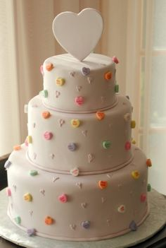 Valentine Cake with conversation hearts as decorations...easy to do but looks cute!