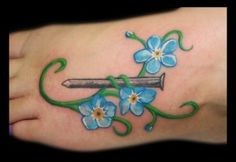 Forget-me-not tattoo. Vines wrapped around cross instead of nail?