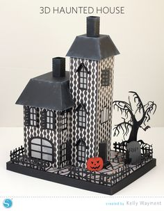 I made a new haunted house for our Halloween decor this year! More pictures and details are over on the Silhouette America blog. Click here to go to the haunted house assembly tutorial.