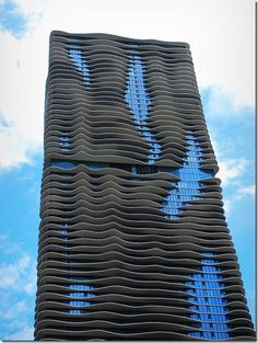 Architect Jeanne Gang's tower is the tallest in the world designed by a woman. building Name is Aqua. Beautiful balconies coming out in waves! also a Green Building. In Chicago.