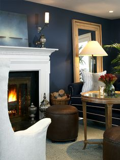 Marblehead Residence - Terrat Elms Interior Design - Deep blue painted walls with white finished fireplace.