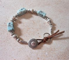 Natural Turquoise Beaded Bracelet with sueded cord and antique silver button closure.  Jewelry from The Mermaid Apothecary via Etsy. com