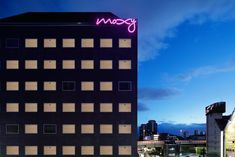 The MOXY is a fun and zesty addition to Tokyo's hotel scene. It's also a nirvana for millennials, with good value no-frills rooms, light-hearted contemporary design, a lively party atmosphere, and a location in a gritty east Tokyo neighbourhood. Tokyo Neighborhoods, Hotel Logo, Contemporary Design, The Neighbourhood, Scene, Japan, Serif, Nirvana, Rooms