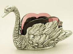 A fine antique Italian silver and cranberry coloured glass in the form of a swan; part of our silverware collection  http://www.acsilver.co.uk/shop/pc/Italian-Silver-and-Cranberry-Coloured-Glass-Swan-Centrepiece-Antique-162p2314.htm