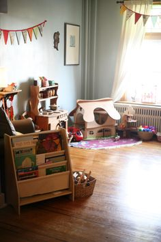 a toy space that clean, creative, mostly wood, and fit right in the living room - is that reality or a dream? good find @Keri Fabin