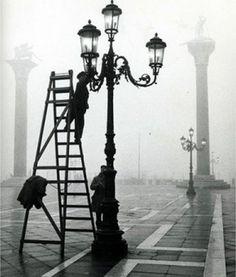 """Lighting the street lamps in San Marco Square, Venice"" 1955, photo by Italian photographer GIANNI BERENGO GARDIN (born 1930)"