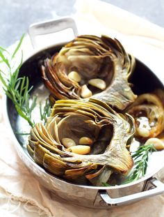 Oven Roasted Artichokes with Roasted Garlic Butter is the most delicious way to prepare artichokes to preserve their delicate flavor!