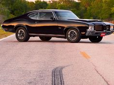 She was Hot, and Cool all at the same time 1972 Cutlass SS had Silver with Black stripes and interior when Shauna was little.