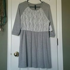 Nwt dress/tunic Brand new with tags, super cute. 3/4 length sleeves, very soft and stretchable. Lace like front panel, perfect as midi dress or as long tunic to wear with leggings and boots. Eric + Lani Dresses