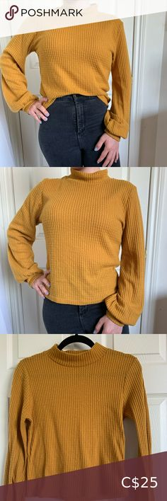 """Caution to the Wind Yellow Long-Sleeved Knit Top Mustard yellow long-sleeved textured shirt. Has a high neck, loose sleeves and fitted around the wrist.  In very good condition. 89% polyester, 9% rayon, 2% spandex.   Size: M Brand: Caution to the Wind Length from shoulder down: 20"""" Sleeves: 22"""" Bust: 20"""" Caution To The Wind Tops Tees - Long Sleeve Mustard Yellow, Long Sleeve Tees, Turtle Neck, Spandex, Knitting, Shoulder, Sleeves, Sweaters, Closet"""