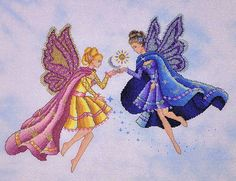 Two fairies, one in pink and yellow and one in dark blue meet and touch exchanging sun and moon.