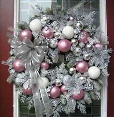 Easily made. Spray wreath with silver metallic paint, sprinkle with silver glitter, use pink, white and silver balls - silver ribbon.