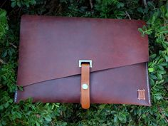 VM's leather folder is a multi purpose stylish leather case for documents, books or your Macbook .
