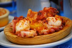 A plate of pulpo (octopus) tapas.