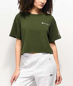 Keep your athleisure looks fashion-forward with the Champion Script green crop t-shirt. A cropped silhouette offers a fashion-forward look overall, while the embroidered logo script on the left chest in white offers crisp and subtle branding too. Cute Crop Tops, Crop Top Shirts, Crop Shirt, Addidas Shirts, Olive Clothing, Champion Clothing, Aesthetic T Shirts, Champion Shirt, Adidas Outfit