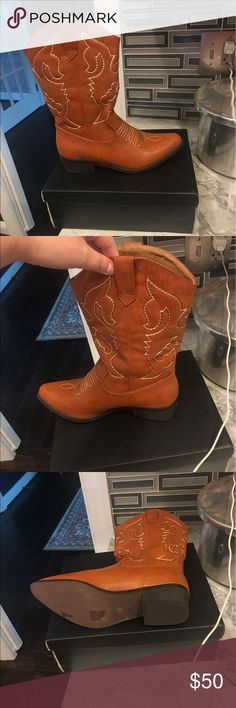 New in box women's brown cowboy boots! New in box women's brown cowboys boots. Boots are technically size 9 but they fit a size 8.5(when I ordered they told me to order up one size and they do fit me) Shoes