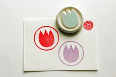 ITEM: tulip hand carved rubber stamp in circle. this series is called kaleidoscope. i put memorable images in circle. each rubber stamps is hand