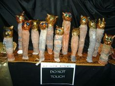 Ancient Egyptian cats at the Museum...(in the classroom). Made by Year 3/4 children.