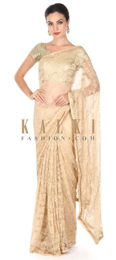 Buy this Cream saree in lace with kundan embroidery only on Kalki