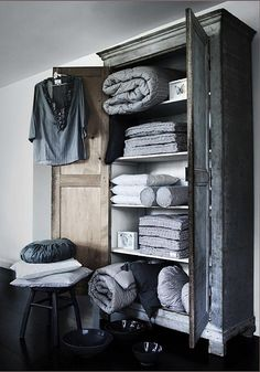 For those of us lacking a proper linen closet, the armoire, scaled to house a full wardrobe, substitutes nicely. Here are a dozen examples of armoires used Linen Cupboard, Home And Deco, Home Interior, Interiores Design, Home Organization, Organizing, Interior Inspiration, Sweet Home, House Design