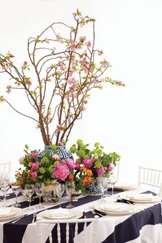 """I had hoped to use long-stem peonies for the center arrangement, but it was too early in the season. So I chose cherry blossom branches instead!"" - Weston designer Sam Allen (Sam Allen Interiors)"