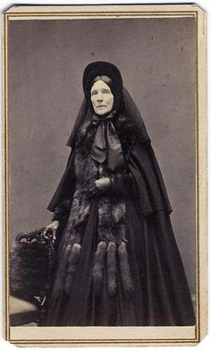 Woman in full Mourning Dress with Furs.