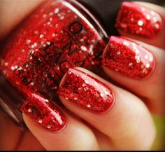 OPI red glitter nailpolish.  Christmasss :]