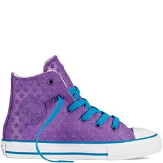 Chuck Taylor All Star Rubber allium purple -- really cute colors, and stars are a nice touch. But rubber? It must be sweltering to wear for long . . . .