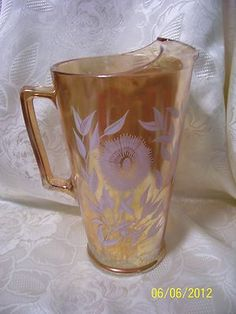 JEANETTE MARIGOLD CARNIVAL GLASS PITCHER, FLORAL COSMOS