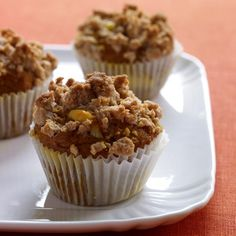 Pumpkin Muffins with Crumb Topping | These moist and tender lightly spiced muffins have a luscious cream cheese filling that is complemented by the cinnamony crumbs on top.