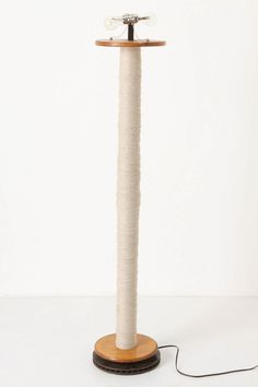 Floor lamp, made from found mid-20th century spindles. for the craft room.