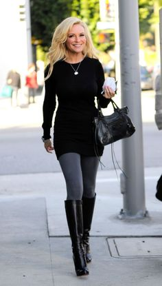 756. Black sweater dress. Bracelets and pendant necklace. Gray tights with black boots.