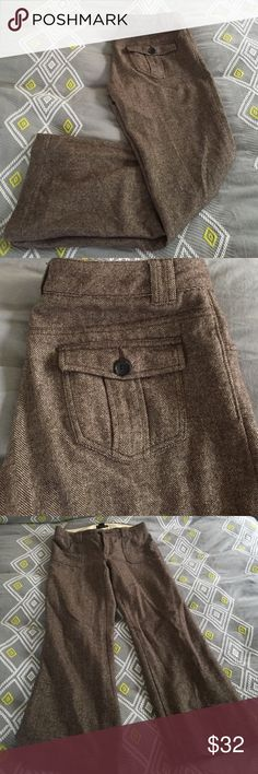 Banana Republic Professional Slacks Gorgeous work pants, colors: cream, dark brown, and tan. It is made of 68% wool, 32% nylon.  Has dark brown lining inside. These are in excellent condition, a little too big for me - must sell! Banana Republic Pants Trousers