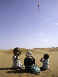 Children with Kite, Morocco Premium Photographic Print by Michael Brown at Art.com