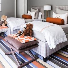 Orange and Gray Plaid Twin Beds with Hermes Orange Bolster PIllows
