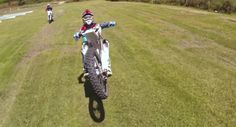 Motocross wheelies captured by Drone camera