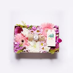 Blossom Case- A mix of seasonal flowers according to your color pallette reference, arranged in a pretty gift box.
