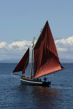 Galway Hooker, a traditional Irish sailboat, under sail. Killilagh, Clare, Ireland.