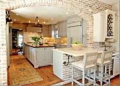 Exposed brick archway in kitchen--love, love, and love