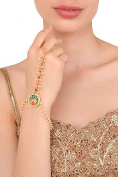 Moh-Maya by Disha Khatri Featuring a gold plated haath phool embedded with real paachi kundan, magenta and emeralds beads and gold, set in base metal. Hand Jewelry, India Jewelry, Trendy Jewelry, 1 Gram Gold Jewellery, Fancy Jewellery, Bridal Bangles, Gold Bangles, Bangle Bracelets, Gold Ring Designs