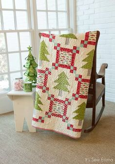 Christmas tree quilt. Pattern in Winter Wonderland 12 cozy Christmas Quilts. Book by Sherri Falls